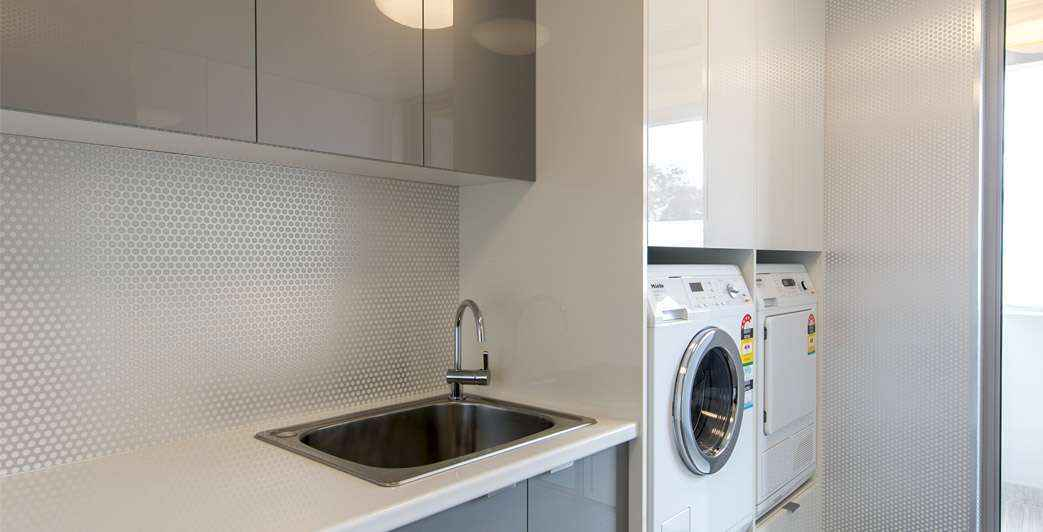 Laundry in a Cupboard Designs | Ikal Kitchens