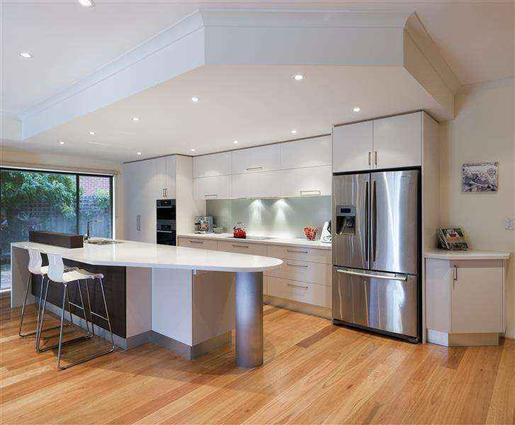 White cabinets with stone bench tops and stainless steel appliances